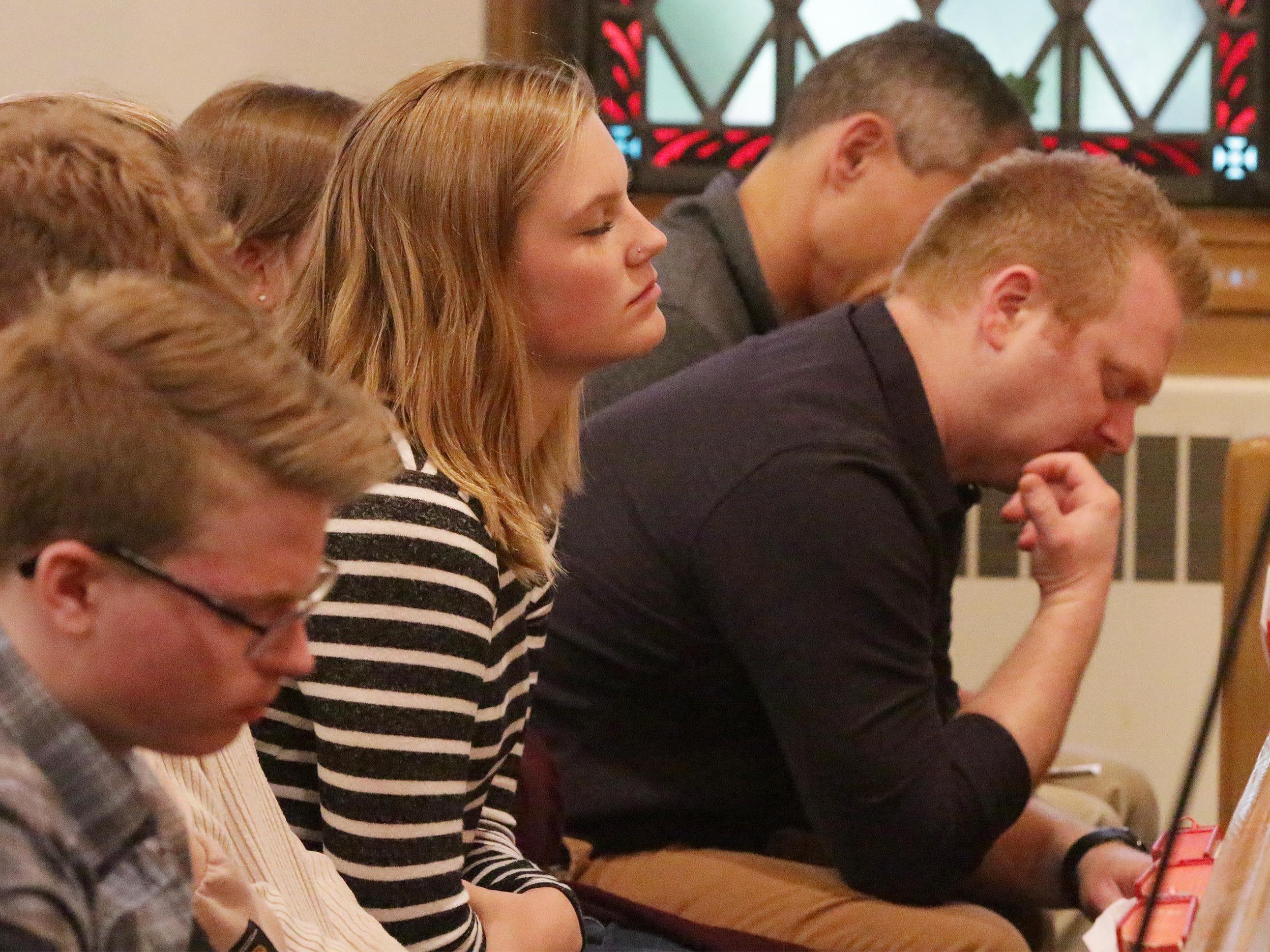 Students pray during the National Day of Prayer, Thursday, May 2, 2019, at Fountain Park Church, in Sheboygan, Wis.