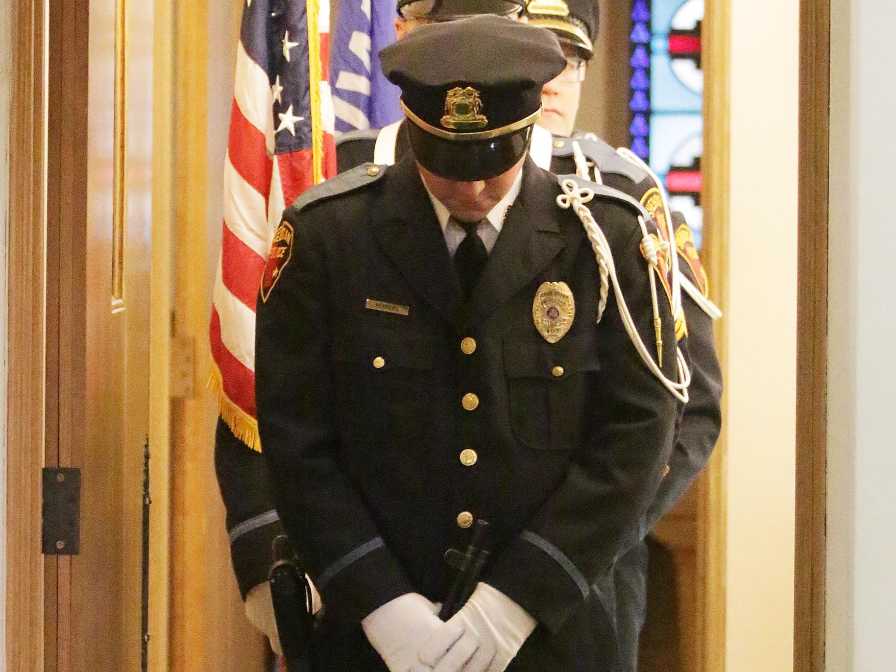 The Sheboygan Police Department Color Unit stands in prayer before the National Day of Prayer service, Thursday, May 2, 2019, at Fountain Park Church, in Sheboygan, Wis.