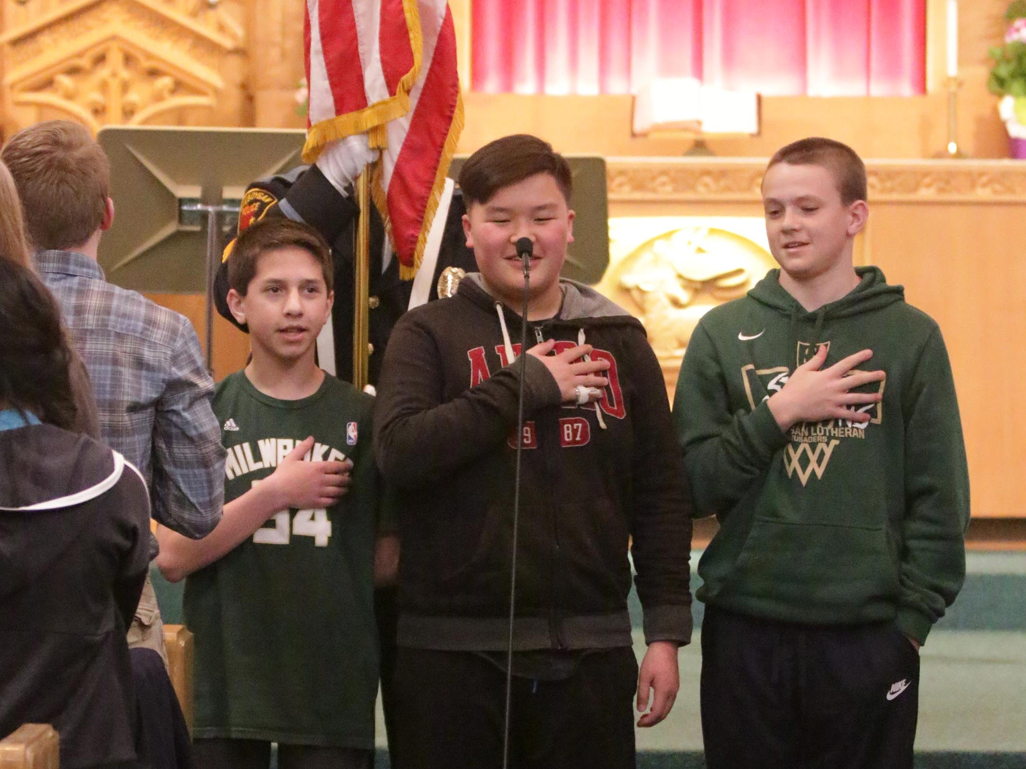 Students from Sheboygan Christian School cites the Pledge of Allegiance during the National Day of Prayer service, Thursday, May 2, 2019, at Fountain Park Church, in Sheboygan, Wis.