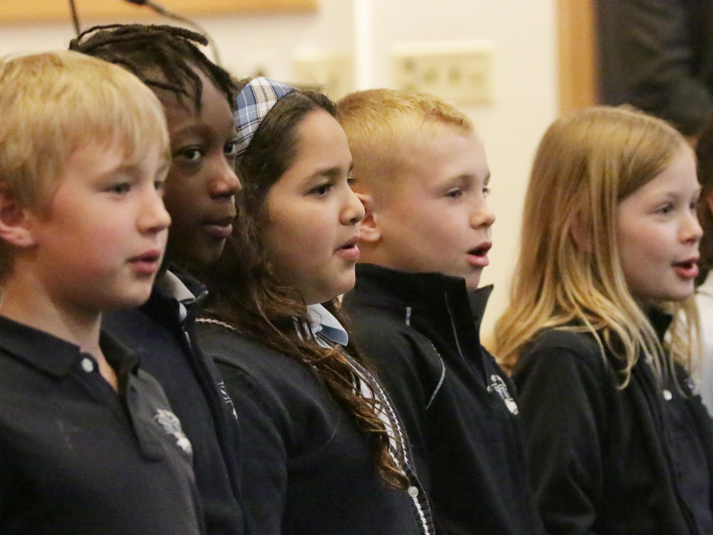 """Students from St. Elizabeth Ann Seton School sing """"God Bless America"""" during the National Day of Prayer service, Thursday, May 2, 2019, at Fountain Park Church, in Sheboygan, Wis."""