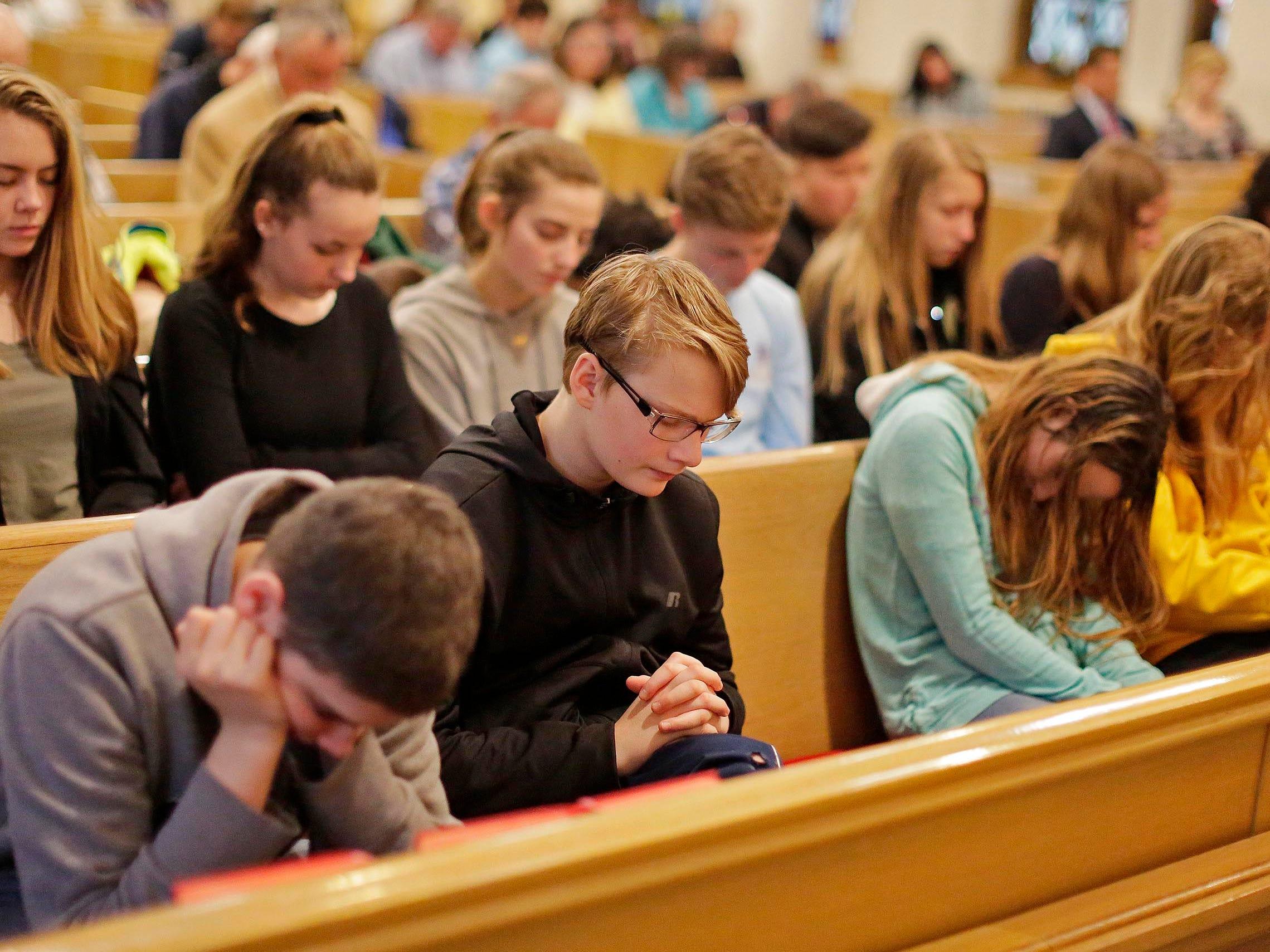Students from Sheboygan Christian School pray during the National Day of Prayer, Thursday, May 2, 2019, at Fountain Park Church, in Sheboygan, Wis.