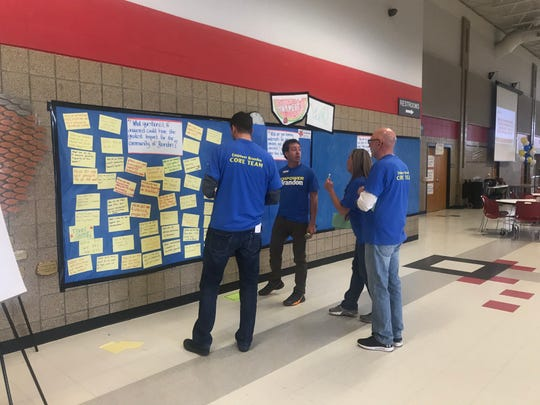 John Beranek from Dakota Resources (center) talks with other Empower Brandon members at the community gathering on Sunday, April 28 at Brandon Valley High School.