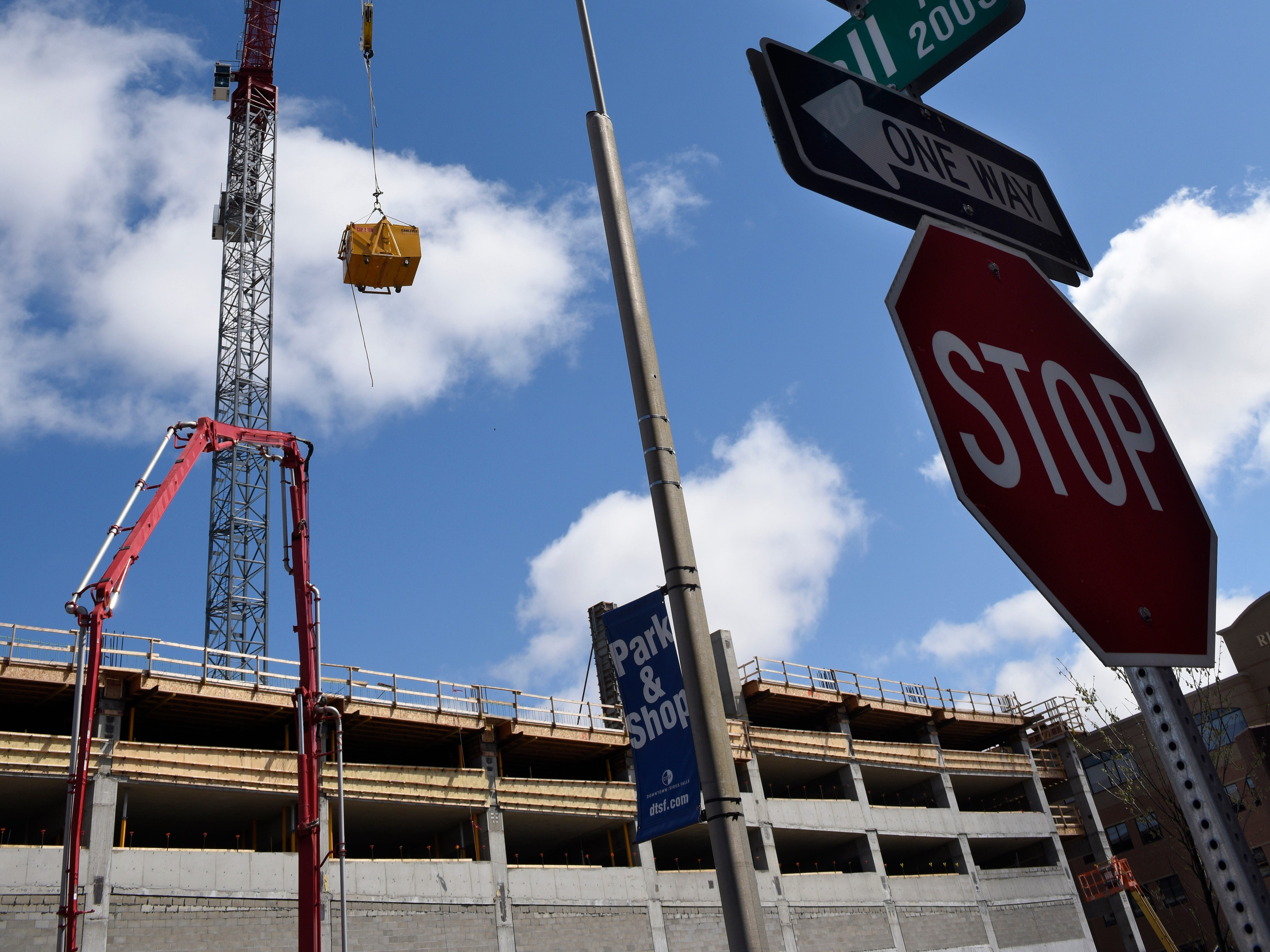 Construction crews pour work on the Village on the River development in downtown Sioux Falls on Thursday, May 2.