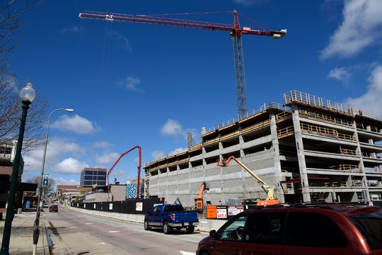Looking west along 10th Street at construction on the Village on the River development in downtown Sioux Falls on Thursday, May 2.