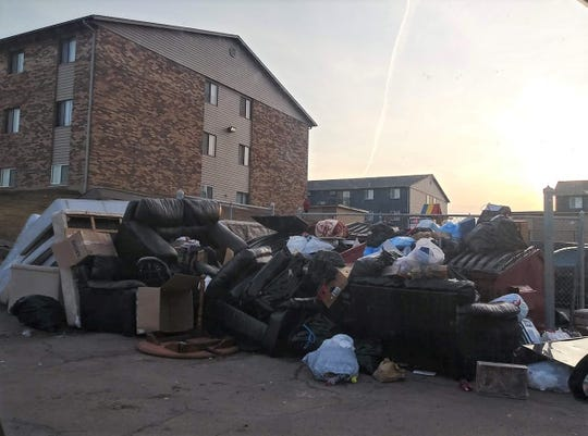 Garbage piled up outside Cleveland Heights Apartments recently, one of several apartment complexes owned by Tzadik Management. Resident Shanna Walker said the garbage was there for weeks but was eventually cleaned up.