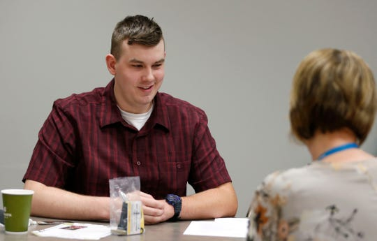 Cordell McCord, 20, talks to a human resources specialist with the city of Springfield during a career fair for people with autism at the Missouri Job Center on Tuesday, April 30, 2019.