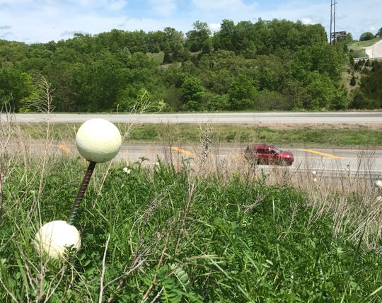 Answer Man:  Why are there white globes stuck in the ground along Ozark Mountain Highroad -- where it ends at Highway 76 -- in Stone County?