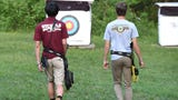 Ethan Avery and Hunter Campbell prepare to represent Virginia in the national 4-H archery championship in June.