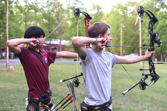 Ethan Avery, left, and Hunter Campbell both qualified for the state 4-H archery team. They will compete in Nebraska in a national event this summer.