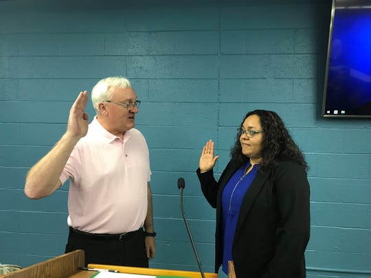 Stevens Point City Clerk Paul Piotrowski swears in Mykeerah Zarazua as District 4 City Council representative on May 1.