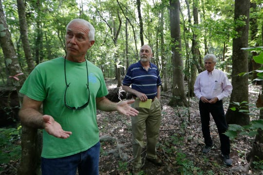 John Outland, retired Florida Department of Environmental Protection administrator, left, J. Terry Ryan, a mortgage banker, and Dr. Howard Kessler, former Wakulla County commissioner, stand in front of a sinkhole Thursday, May 2, 2019. They are concerned about environmental impacts from a city of Tallahassee project to extend Weems Road.