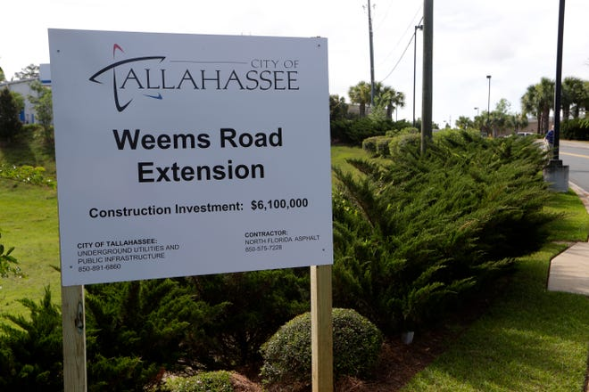 A sign for the city of Tallahassee's project to extend Weems Road across Mahan Drive, linking it to Capital Circle Northeast via Automotive Way Thursday, May 2, 2019.