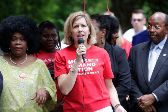 Kate Kile, the local Tallahassee. Leader for Moms Demand Action, talks at a press conference addressing recent gun violence in the Bond neighborhood and Tallahassee community Thursday, May 2, 2019.