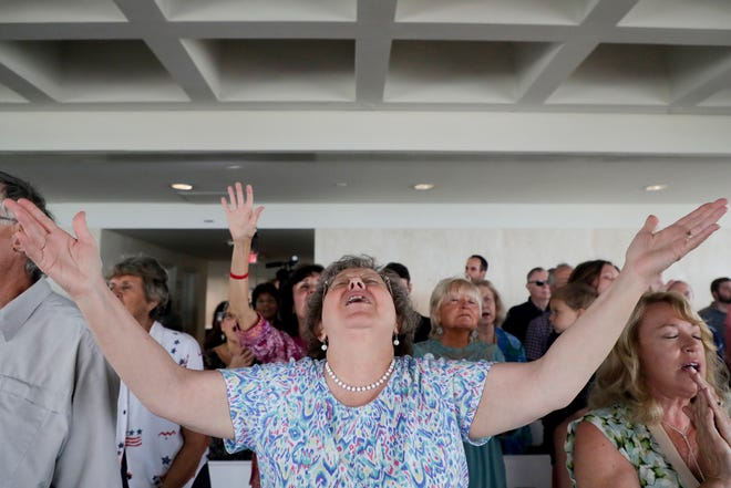 Denise Whitfield, who lives in Thomasville, Ga., who practices Messianic Judaism, opens herself up in prayerful song during a celebration of National Day of Prayer at the Capitol Thursday, May 2, 2019.