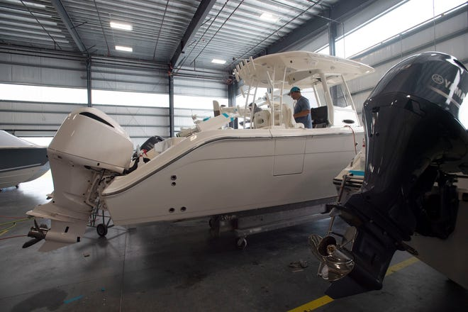 The steps of the boat building process, including fiberglass laying, laminating, infusion, hull harness and hose kit assembly, trim assembly and quality control, are seen Friday, April 19, 2019, at the new 126,000 square foot Maverick Boat Group facility in Fort Pierce. Maverick Boat Group employs 427 people and produces about 35 boats a week that get distributed to about 55 dealers across the country and exported to Europe, the Caribbean, Central America and Australia.