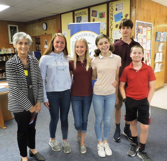 Kate Boland, left, board chair for Center for Constitutional Values, with Kahoots! participants Brynn Stoneburg, Laila Mayfield, Zoe Berry, Dakota Short and Tyler Baird.