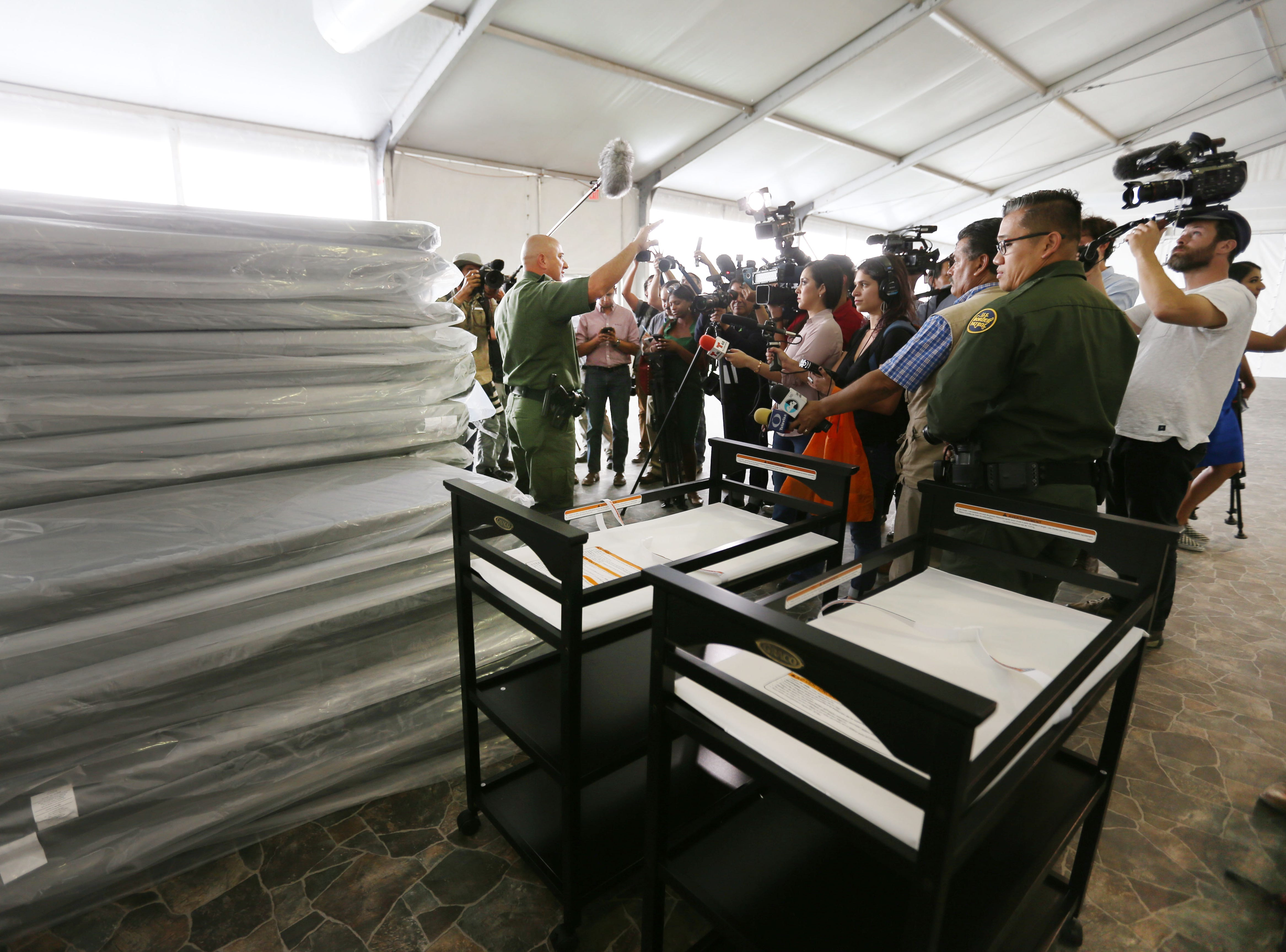 Border Patrol agent Ramiro Cordero gives a media tour of a new temporary holding facility Thursday, May 2, located at 9201 Gateway S. Blvd. in El Paso. The 32,000 square foot facility is broken into four sections. Each section can hold 125 people.