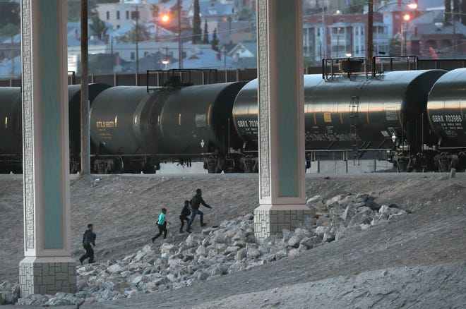 A family makes their way from Juarez into El Paso near the Chihuahuita neighborhood.