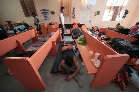 """Migrants find anywhere they can to sleep at the Albergue Para Migrantes """"El Buen Pastor"""" in Juarez as they await their number to be called by U.S. authorities for their asylum hearing."""