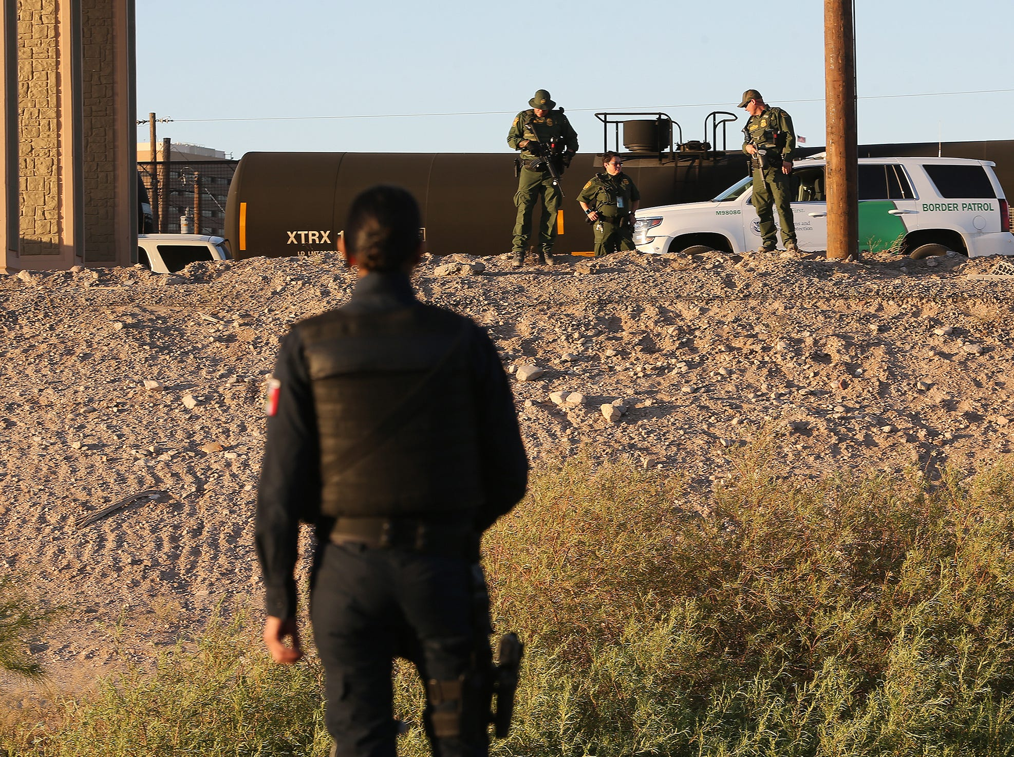 Juarez Municipal Police help U.S. Border Patrol search for a subject Wednesday.