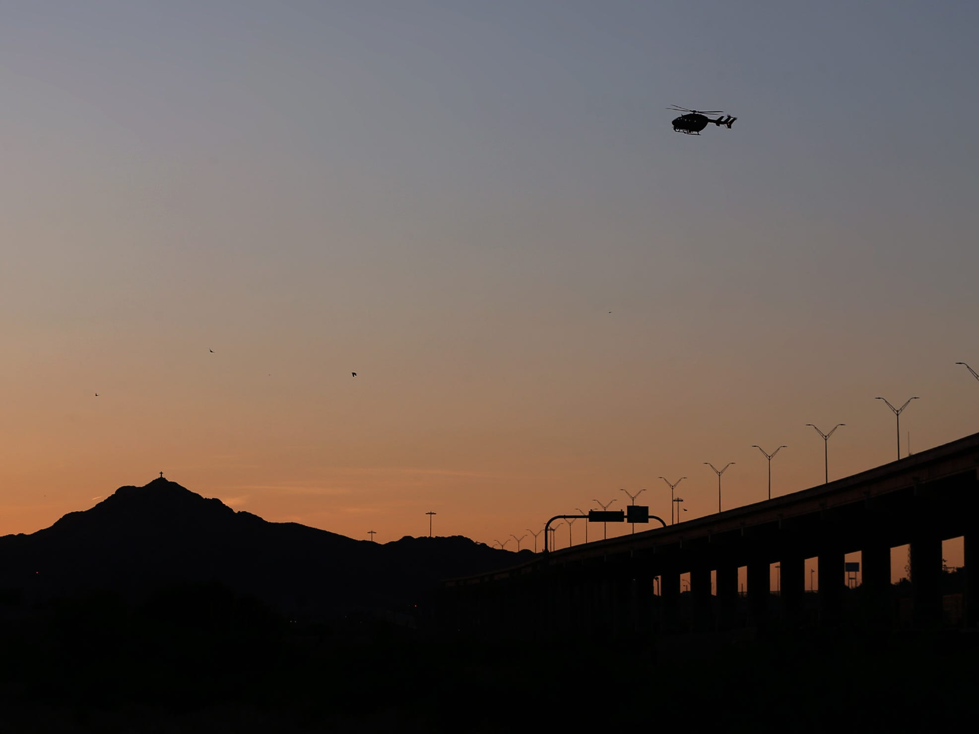 An ICE hellicopter patrols the border between downtown and Mount Cristo Rey as asylum seekers continue to flow across the border.