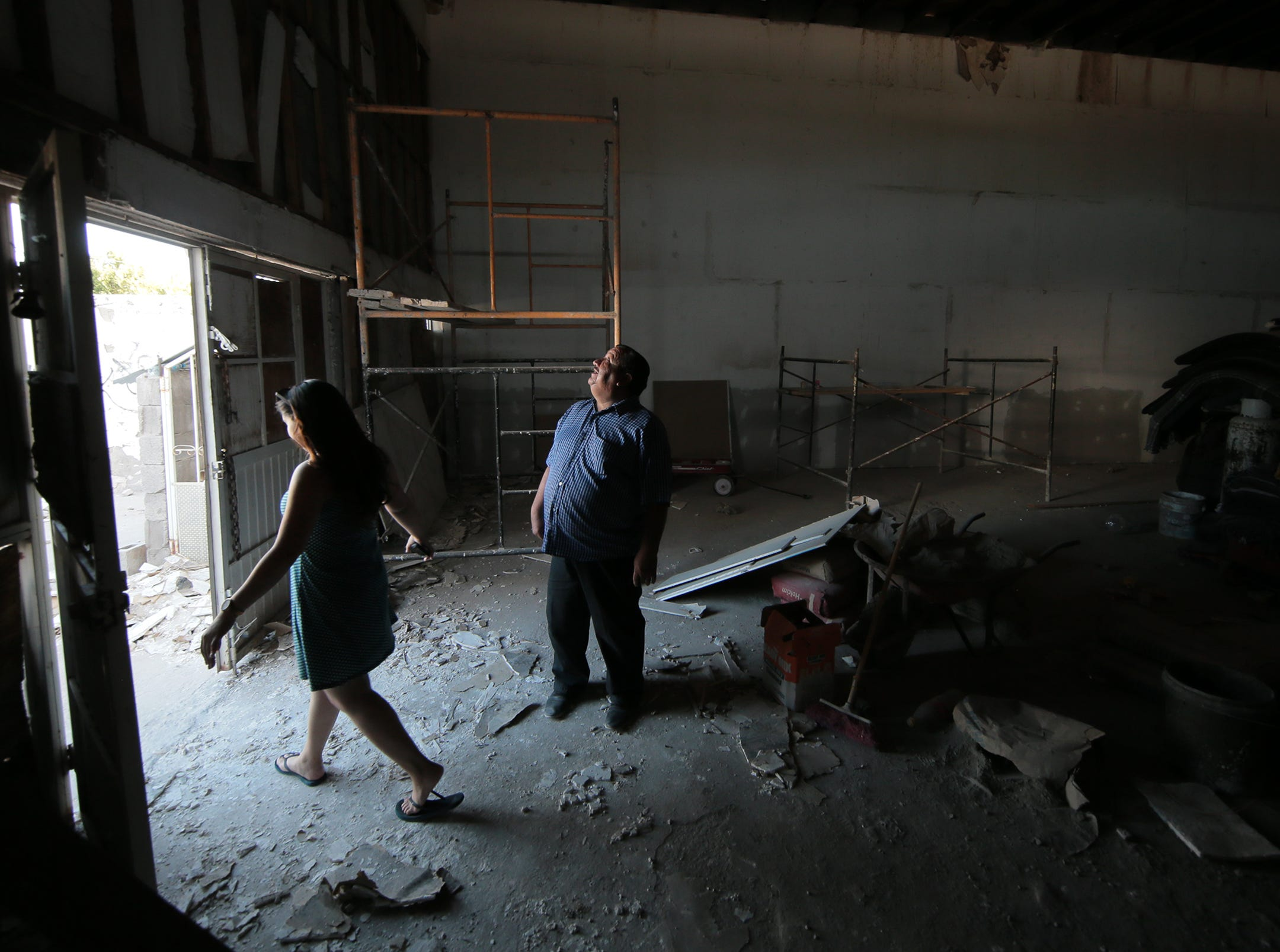 """Juan Fierro looks through a warehouse across from his current migrant shelter in Juarez he is converting into more space to house asylum seekers. His current shelter, Albergue Para Migrantes """"El Buen Pastor"""" has been full since the influx of migrants began."""