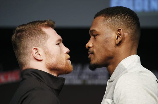 Canelo Alvarez, left, and Daniel Jacobs pose at a news conference Wednesday  for their middleweight title match set for Saturday night in Las Vegas.