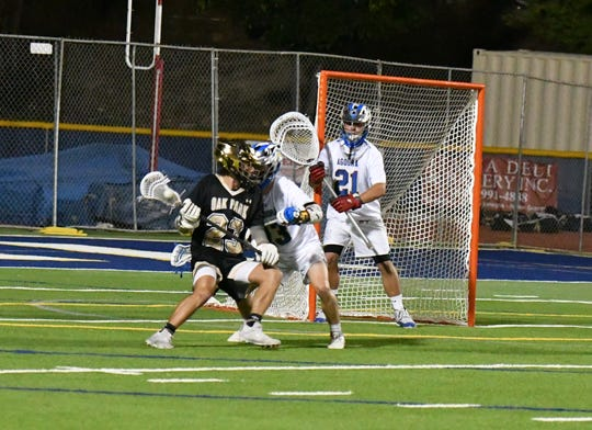 Little more than two years after volunteering to change his position, Agoura High senior Zach Tripp (21) has developed into one of the top lacrosse goalies in Southern California.