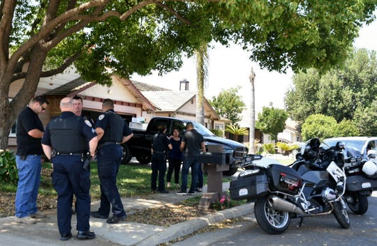 Visalia Police officers investigate a stabbing at a home on Manzanita Street near Pershing Avenue on Thursday, May 2, 2019.