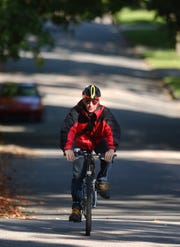 Doug Hosler has been known for years on campus and in the community as the philosophy professor who bikes almost everywhere, in almost every kind of weather.