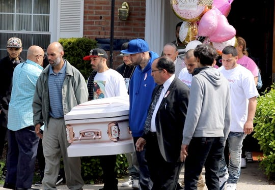 Eugenio Cotto, left, the brother of the victim and family and friends carry the casket toward the hearse, after a funeral service at the Community Homes for Funerals in Yonkers May 2, 2019, for Marilyn Cotto Montanez, an 18-year old Yonkers resident killed by gunfire last week.