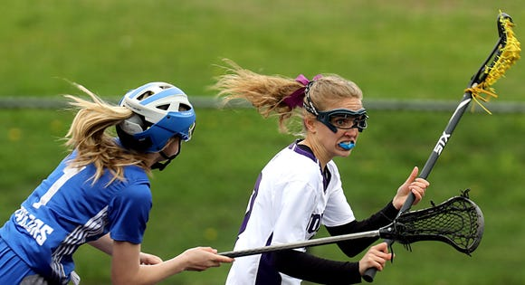 John Jay-Cross River's Cameron Crawford races downfield, chased by Hen Hud's Brooke Montgomery during a May 1, 2019 game that John Jay won 11-10 in overtime.