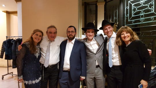 At a Crown Heights wedding last month, (from left) Lori Gilbert-Kaye, her husband Howard; and fourth from left, Danny Renzoni and far right, Meira Renzoni.