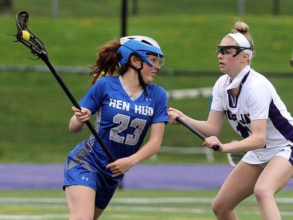 Hen Hud's Kira Varada (23) looks for an opening as John Jay-Cross River's Jenna Giardiana defends during a May 1, 2019 girls lacrosse game at John Jay. John Jay won 11-10 in overtime.