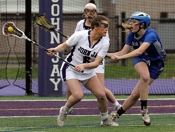 John Jay-Cross River's Cara O'Reilly with ball deep in Hen Hud territory during May 1, 2019 game at John Jay. The Indians defeated Hen Hud 11-10 in overtime.