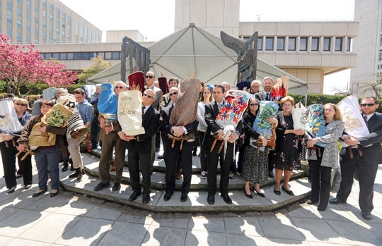 Twenty-five rescued Holocaust Torahs participated in a procession during the annual Westchester County Yom Hashoah Holocaust Commemoration May 2, 2019 at the Garden of Remembrance in White Plains.