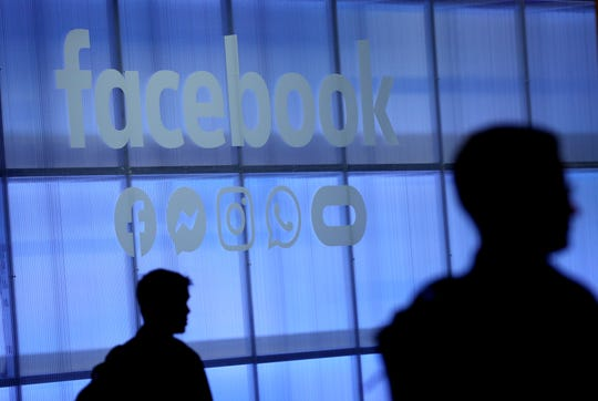 The Facebook logo is displayed during the F8 Facebook Developers conference on April 30 in San Jose, California.