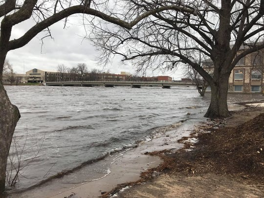 The Wisconsin River floods the East Riverbank Conservancy Area, along Second Street South in Wisconsin Rapids, Thursday, April 18, 2019.