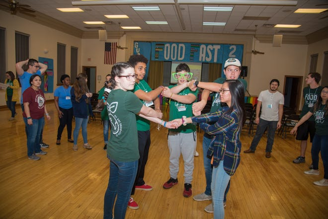Teens participating in Food Fast, a 22-hour event at Sacred Heart that was held in March, got energized over the long night with various games and crafts.