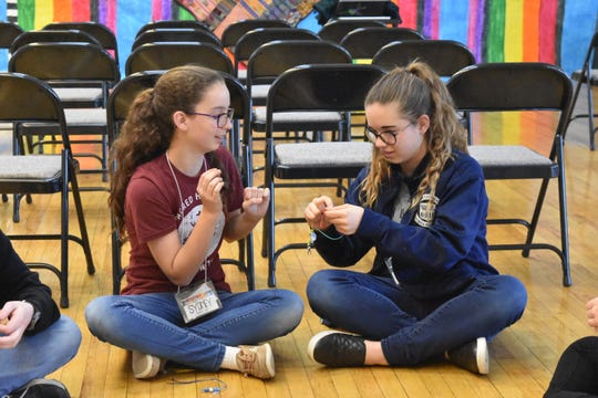 Teens participating in Food Fast, a 22-hour event at Sacred Heart that was held in March, got energized over the long night with various games and crafts. FF sticks, an exercise that was taught by instructors from the YMCA, involved beating drums to the rhythm of music.