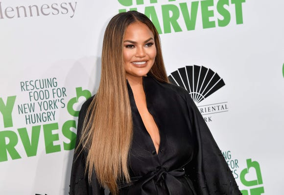 Chrissy Teigen says that going through postpartum depression with Luna helped her feel better prepared when she was pregnant with Miles.