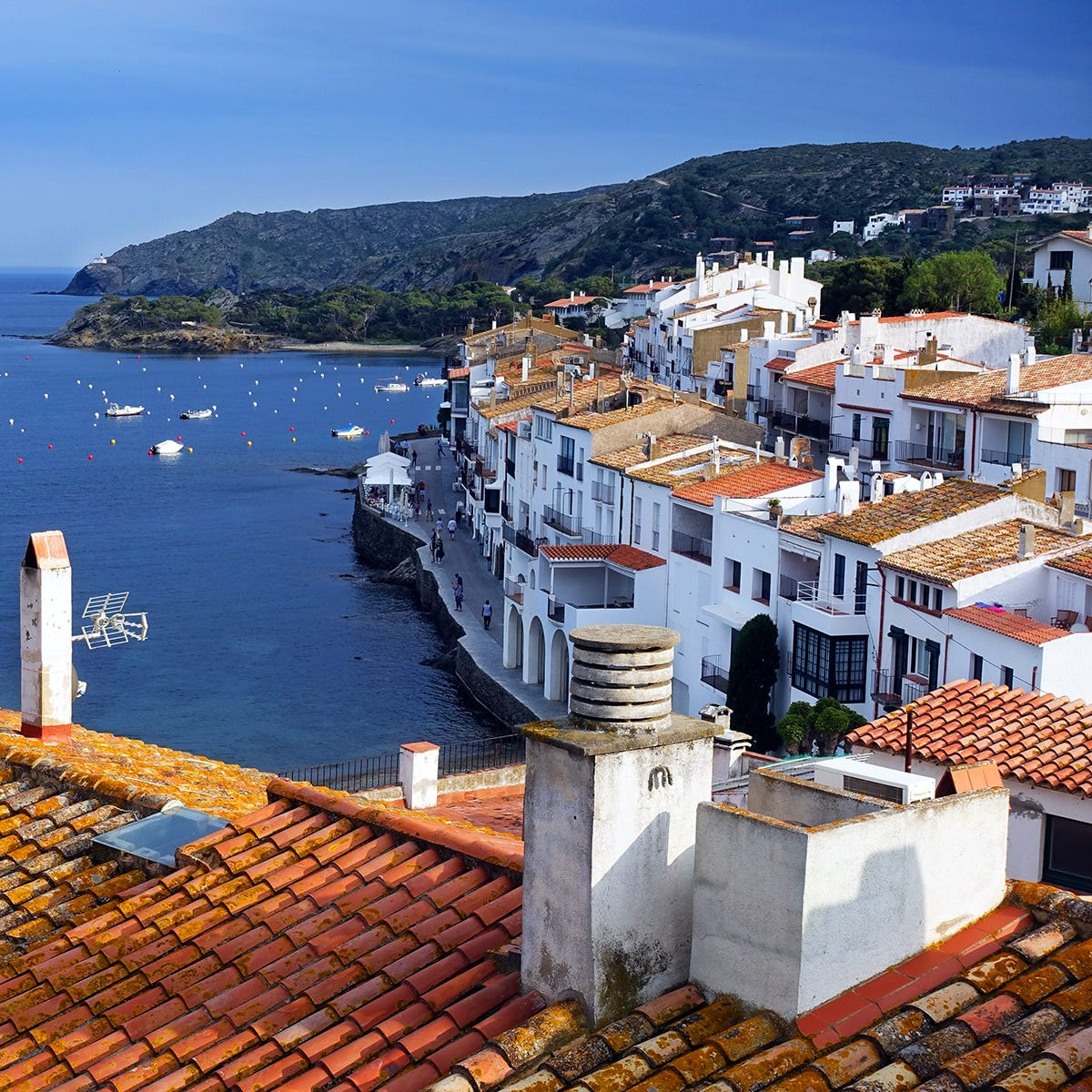 Spain's sunny port town of Cadaqués is an idyllic alternative to the glitzy Mediterranean resorts nearby.