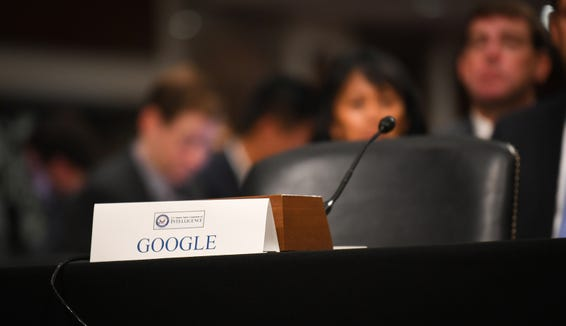 An empty chair and placard for Google in place beside Sheryl Sandberg, chief operating officer of Facebook Inc., and Jack Dorsey, chief executive officer of Twitter Inc., before testimony before the Senate Select Committee on Intelligence  on Sept. 5, 2018, in Washington.