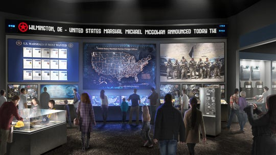 This artist's rendering provided by the United States Marshals Museum depicts a proposed exhibit at a future museum in Fort Smith, Ark., showing the work U.S. Marshals do today.