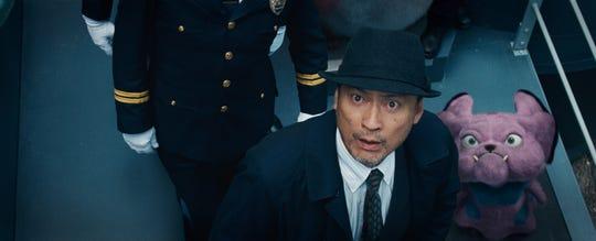 "Detective Yoshida (Ken Watanabe) always has his loyal Snubbull by his side in ""Pokemon: Detective Pikachu."""