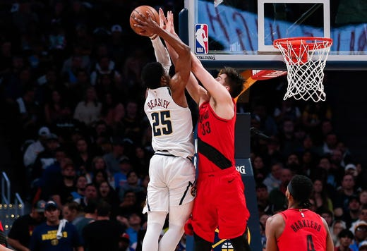 May 1: Blazers defender Zach Collins (33) stops Nuggets guard Malik Beasley (25) at the rim during Game 2.
