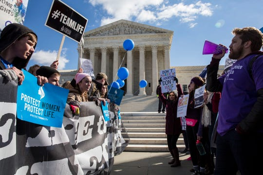 Pro-choice and anti-abortion advocates demonstrate outside the Supreme Court in 2016, when the justices heard a major case from Texas on abortion restrictions. An almost identical case from Louisiana is pending now.