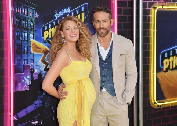 "US actress Blake Lively and husband Canadian actor Ryan Reynolds attend the premiere of ""Pokemon Detective Pikachu"" at Military Island - Times Square on May 02, 2019 in New York City."