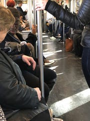 A squirrel perches on the arm of a Red Line Massachusetts Bay Transportation Authority commuter trolley in Boston on Monday.