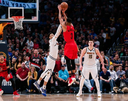 May 1: Trail Blazers guard C.J. McCollum (3) rises up for the jumper over Nuggets defender Jamal Murray (27) during Game 2 in Denver.